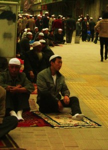 Muslim men in China at the daily prayer time